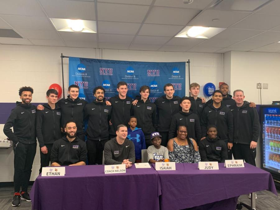 """The NYU men's basketball team official welcomes 11-Year-Old Isaiah Mitchell to the team on Team IMPACT's """"Draft Day"""" Ceremony. Mitchell has brought positive energy to the team and inspired them to work even harder. (Staff Photo by Arvind Sriram)"""