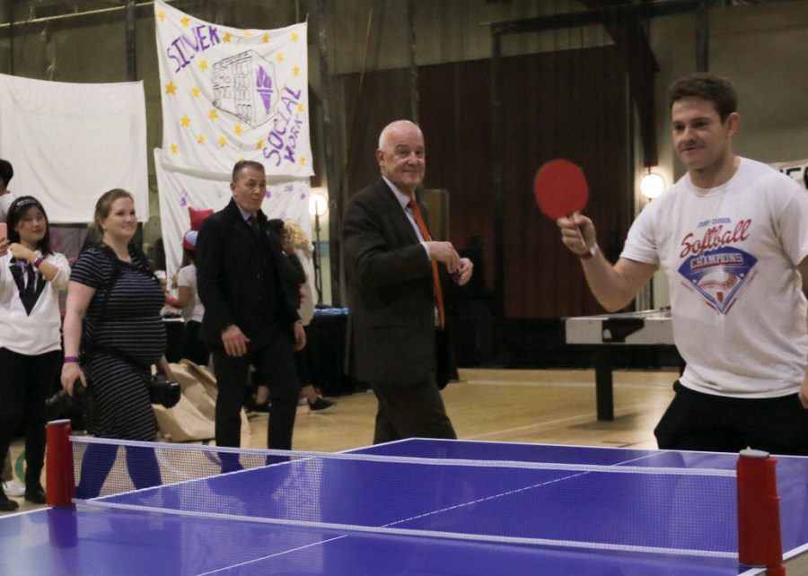 NYU+President+Andrew+Hamilton+stops+to+view+a+particularly+intense+table+tennis+game.+Representatives+from+each+NYU+school+participated+in+various+sports+at+the+All-University+Games.+%28Staff+Photo+by+Alex+Tran%29
