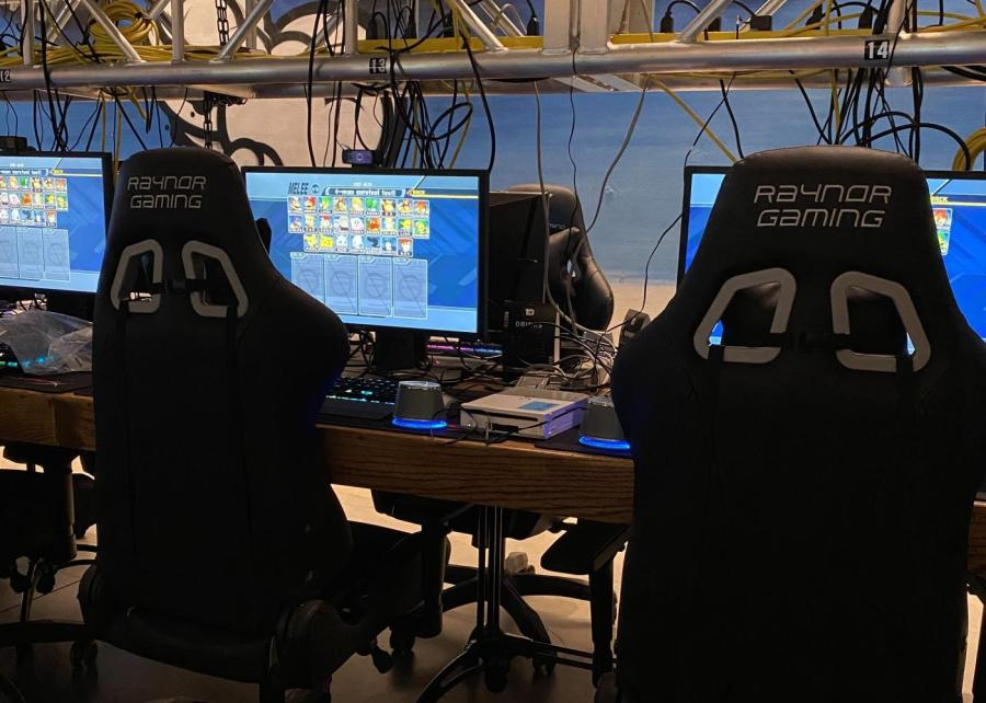 Computer stations designed for playing video games are characterized by brightly lit keyboards and high-backed chairs. The video game industry has been rapidly rising, forming a vibrant community of players, programmers, and audiences. (Photo by Isiah Rosa)