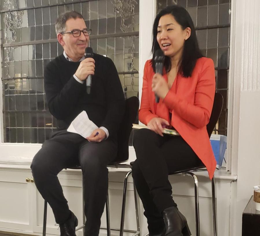 "Poet Tina Chang discusses her newest book with Matt Brogan, executive director of the Poetry Society of America, at the Lillian Vernon Creative Writers House. Chang's collection of poems, titled ""Hybrida,"" grapples with issues of identity and acceptance. (Photo by Dani Herrera)"