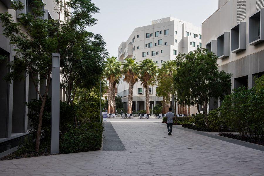 A student walks through NYU Abu Dhabi's campus. NYUAD is the last of NYU's campuses to remain open amid the outbreak of the coronavirus. (Photo by Sam Klein)