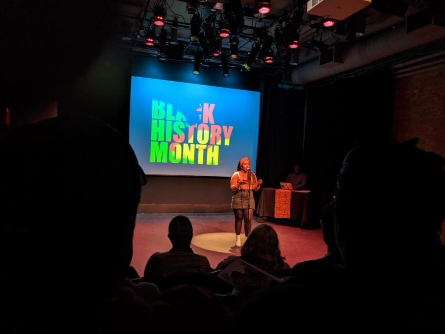 """Mekleit Dix, a first-year Master's student in Gallatin, was one of many artists who performed during the school's """"Say It Loud!"""" showcase. Concluding Black History Month, artists shared messages of unity and pride. (Photo by Destine Manson)"""