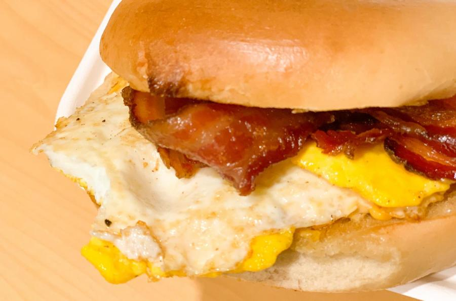 Bacon, egg and cheese bagel can be the best cure after a crazy night. While you can get it anywhere from dining halls to food trucks, it is best at Tompkins Square Bagels. (Staff photo by Alex Tran)