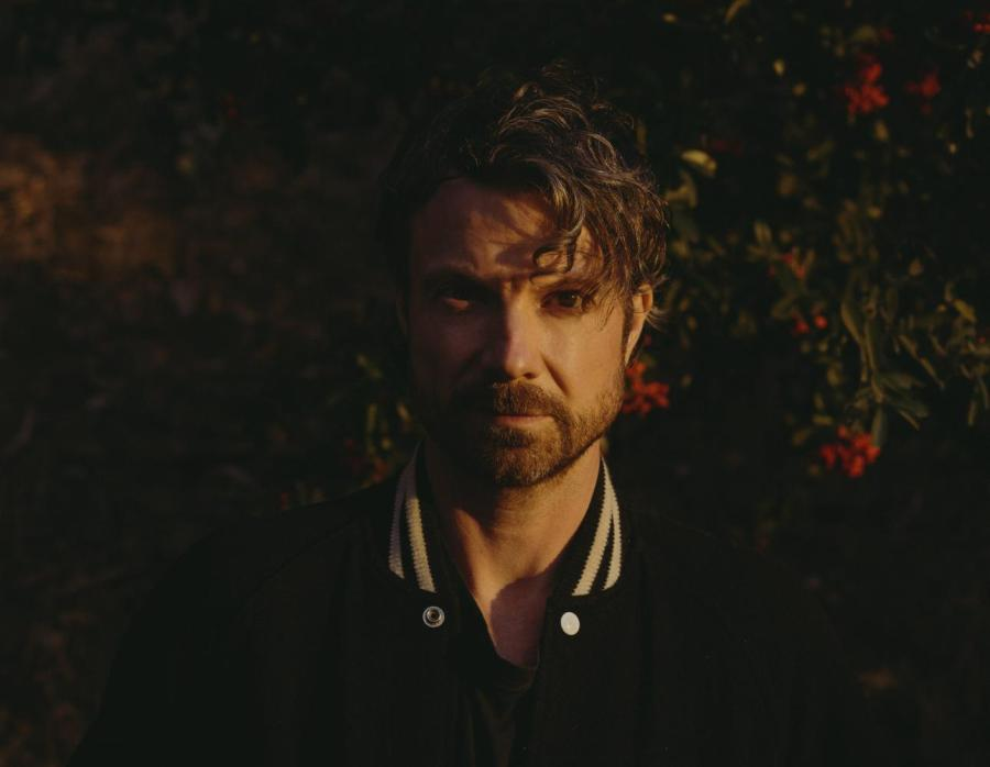 """Alex Brown Church, better known as Sea Wolf, is an NYU alum and Los Angeles based indie folk musician. After 6 years since his last album """"Song Spells, No. 1: Cedarsmoke, he has just released Through A Dark Wood, a record which is, in his word, catharsis. (Photo courtesy of Shane McCauley)"""