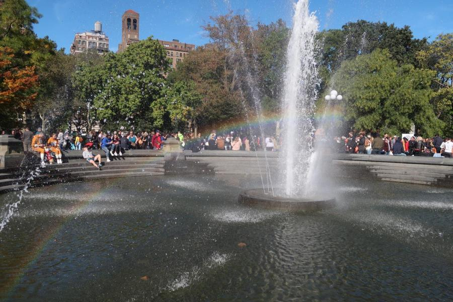 Washington Square Park's iconic fountain is often turned on when the weather begins to warm. Though the park provides a laid-back place to hang out on sunny days in the city, students reflect on enjoying spring in their respective hometowns. (Staff Photo by Chelsea Li)