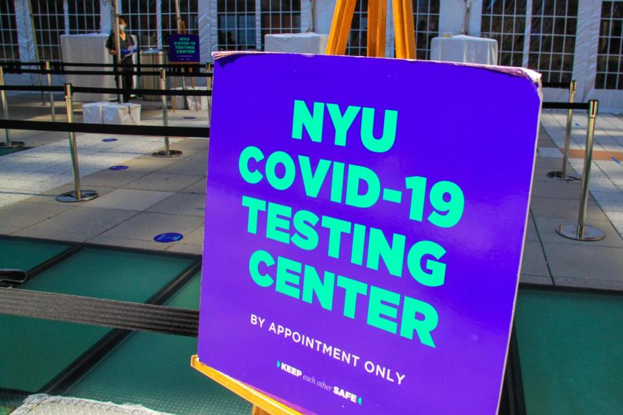 NYU students go through mandatory COVID-19 testing at the testing site on Gould Plaza prior to the start of classes. New York Governor Cuomo unveils new policy that would mandate two weeks remote learning for any university reporting 100 COVID-19  cases or a number of COVID-19  cases exceeding 5% of the student population. (Staff Photo by Alexandra Chan)