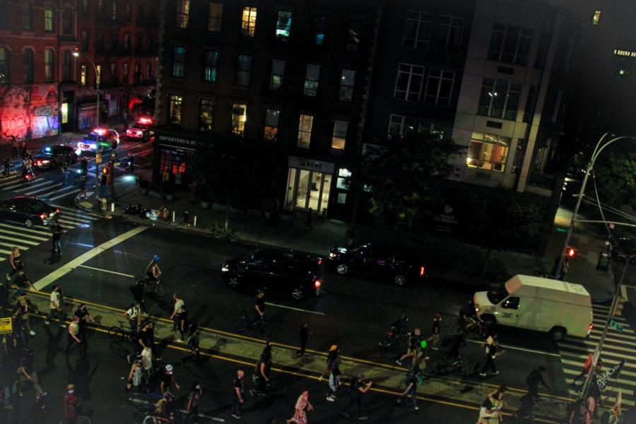 A group of protesters head down Bowery, as one of many groups protesting in NYC. (Staff Photo by Alexandra Chan)