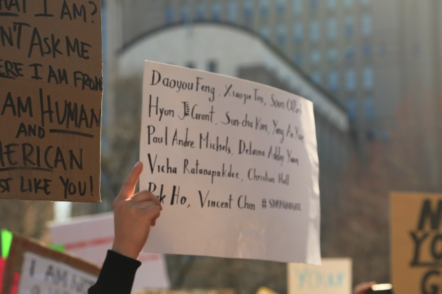 A protester holds up a sign commemorating the victims from recent anti-Asian hate crimes. (Photo by Suhail Gharaibeh)