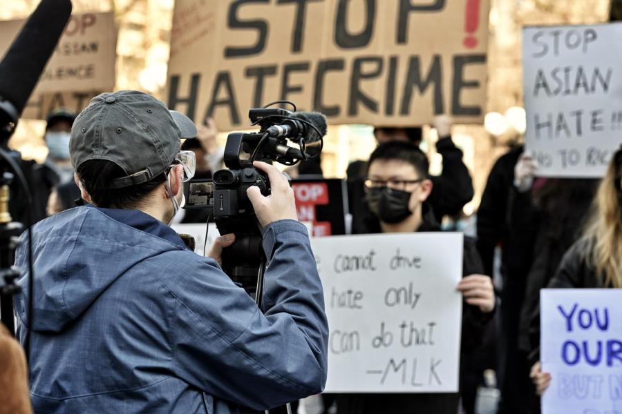 A reporter records footages during the recent protest against Asian hate crimes. (Photo by Sirui Wu)