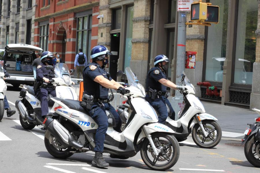 Police officers ride by Bobst. Mayoral candidate Andrew Yang's policies do nothing to curb the issue of police power in New York City. (Staff Photo by Alexandra Chan)