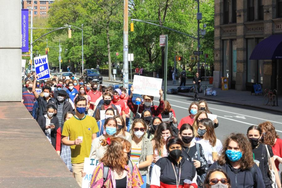 Supporters march from Schwartz Plaza to Gould Plaza at Stern.