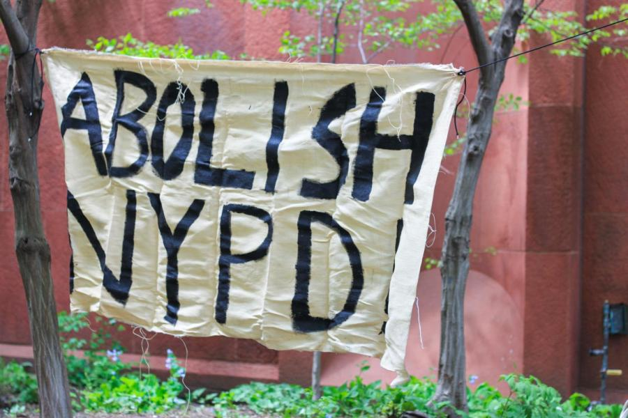 A banner reads Abolish NYPD begins the cops off campus segment.