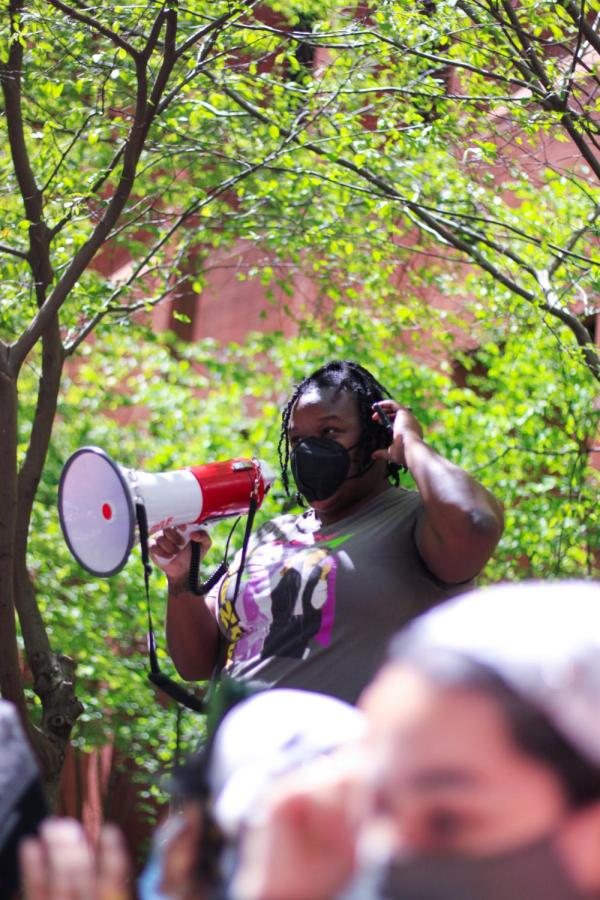 Abolish organizer leads the crowd in a chant.