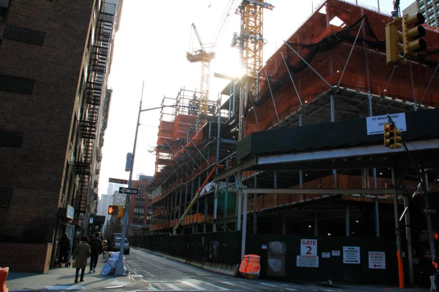 NYU continues construction on 181 Mercer Street in SoHo gentrifying the area. Mayor DeBlasio's plan for affordable housing in the area does not serve the public interest of the surrounding area. (Staff Photo by Alexandra Chan)