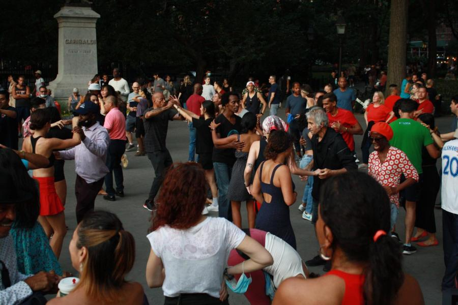 Salsa learners gather at Washington Square Park for their lesson. Free salsa lessons are scheduled between 5:30pm to 8:00pm every Tuesday till the end of September. (Photo by Maria Freyre)