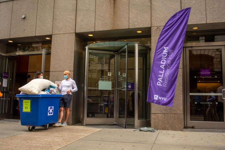 Students and their helper guests moved into NYU's 22 residence halls during three move-in days. Students new and returning seemed undeterred by the university's COVID guidelines surrounding move-in and reported a generally smooth process. (Staff Photo by Jake Capriotti)