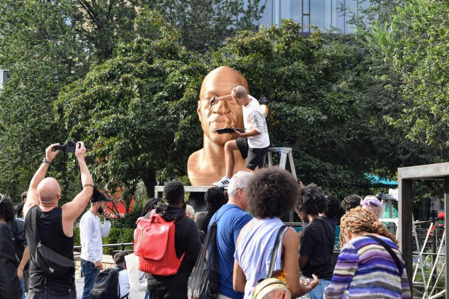 Arts activism group Confront Art repainted their statue of George Floyd after it was vandalized on Oct. 3. The statue is part of the SEEINJUSTICE installation, which memorializes key figures from the 2020 racial injustice protests. (Staff Photo by Ryan Kawahara)