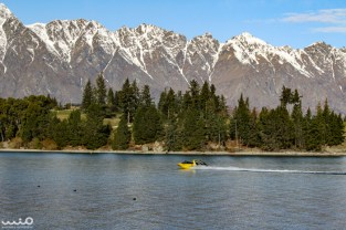 A jet boat jets away on Lake Wakatipu