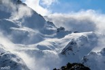 High winds kick up the snow on the tops of the mountains in the Mt Cook Range.