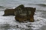 Wild waves crash against eroding rocks at Punakaiki.