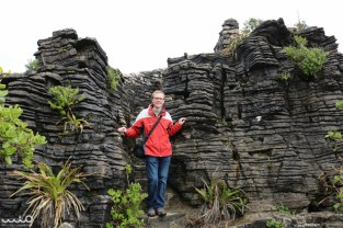 William standing on a stairway down the pancake rocks (which was actually over an eroded archway over the water)