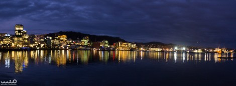 Panorama of Wellington shining on its harbor at night--a vibrant city!