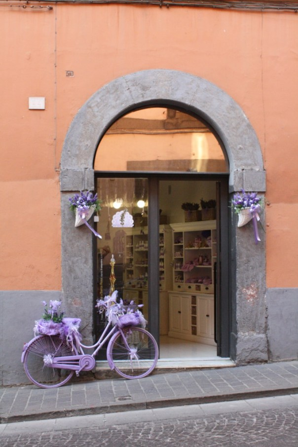 Purple bicycle outside a shop in Viterbo, Italy