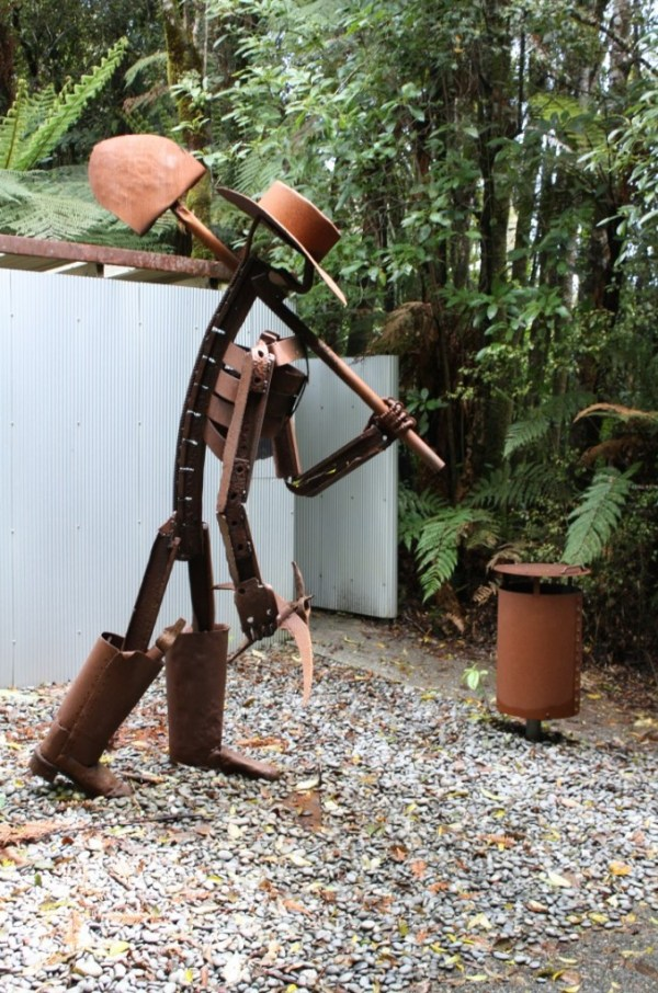 Shantytown miner sculpture