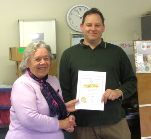 Tim receiving his award from Barbara Streeter