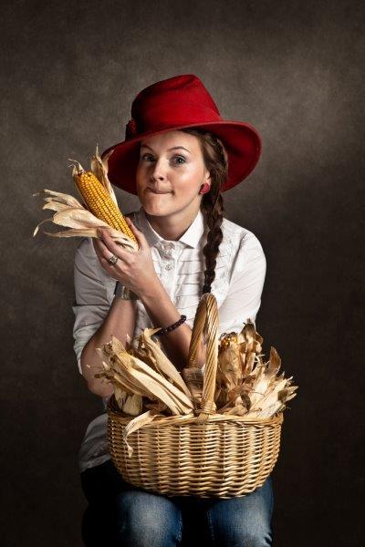 Meisje met maïs