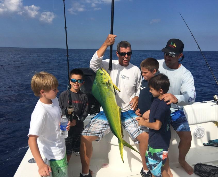 kids fishing for mahi