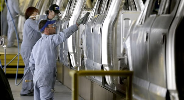 FILE - In this March 13, 2015 file photo, workers inspect the new aluminum-alloy body Ford F-150 trucks before they get painted at the company's Kansas City Assembly Plant in Claycomo, Mo. The Commerce Department releases its September report on durable goods on Tuesday, Oct. 27, 2015. (AP Photo/Charlie Riedel, File)