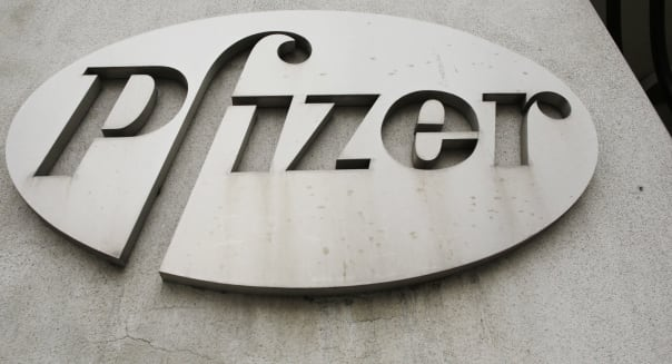 FILE - In this May 4, 2014, file photo, the Pfizer logo is displayed on the exterior of a former Pfizer factory in the Brooklyn borough of New York. Pfizer and Allergan have reached a $160 billion deal that creates the world�s largest drugmaker by sales, the companies announced Monday, Nov. 23, 2015. (AP Photo/Mark Lennihan, File)