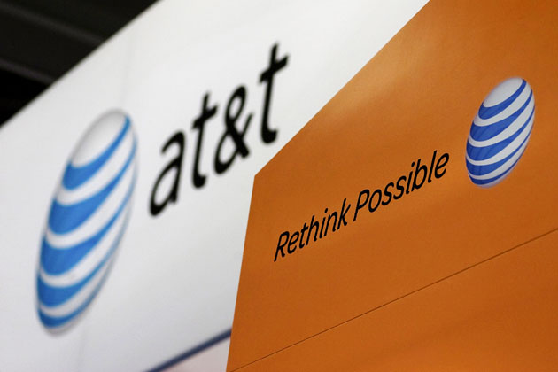 The At&T Inc. logo is displayed during the CTIA Enterprise & Applications conference at the Moscone Center in San Francisco, California, U.S., on Thursday, Oct. 7, 2010. The number of smartphone owners in the U.S., the biggest market for the mobile devices, rose 11 percent to 53.4 million in the quarter ended July, accounting for 23 percent of global shipments. Photographer: David Paul Morris/Bloomberg via Getty Images