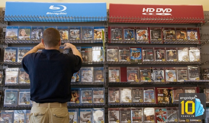 Blockbuster manager Christopher Borghese arranges discs in t