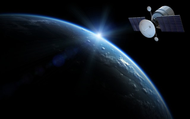 A generic communications satellite in orbit above Earth