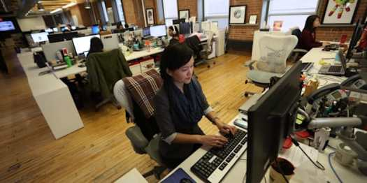 Lisa Yeung, HuffPost Canada's managing editor of lifestyle, works in the Toronto newsroom in March 2016.