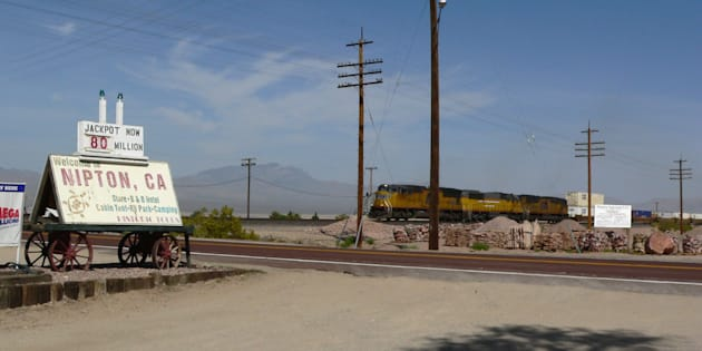 A photo of the railroad crossing in Nipton, Calif. Cannabis company American Green has bought the town's land and facilities in order to develop a marijuana tourism destination.