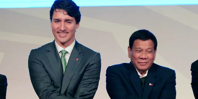 Prime Minister Justin Trudeau holds hands with Philippines' President Rodrigo Duterte during the ASEAN summit in  Manila on Nov. 14, 2017.