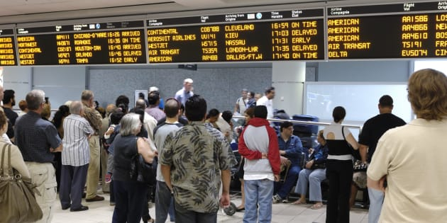 People waiting at an arrival hall at Toronto's Lester B. Pearson Airport. New data from Statistics Canada shows Canada's reliance on immigration for population growth is at an all-time high.