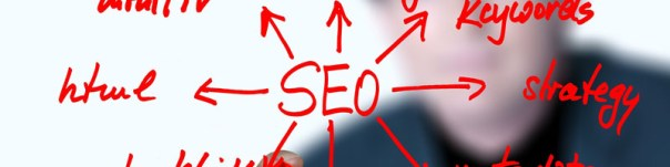 Red writing on a transparent board with SEO as the focal point with arrows pointing out to other areas of work with html and strategy clearly visible from O2 REAL
