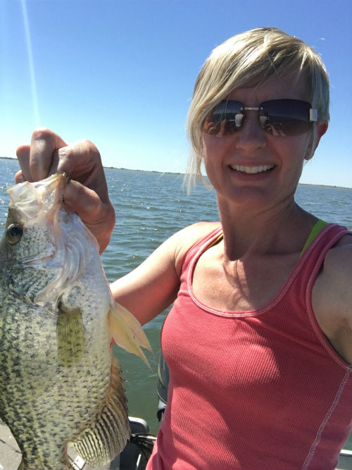 My wife showing off a crappie with nice shoulders.