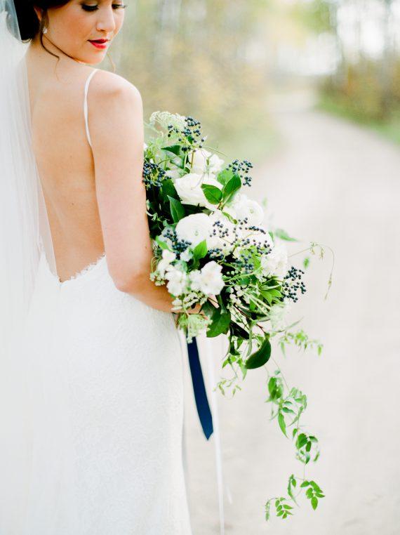 White and blue bouquet by Oak & Lily Flowers Photo by Brittany Mahood br-wedding333