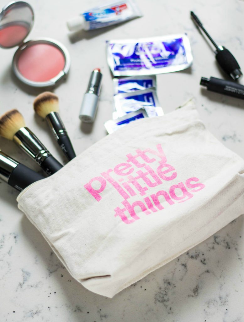 What to pack in your carry-on travel make up bag! I am so in love with these GREAT travel tips during travel season! Throwing in Crest 3D White Professional Effects Whitestrips is such a great idea! Think of all the Holiday pictures!