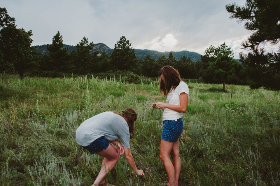 Elizabeth Mayberry Life Style Blogger at  Oak + Oats in Patagonia Shorts. Love the wildflowers and sunset.