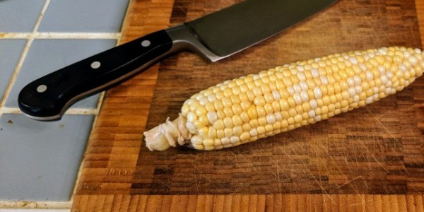 Wusthof 6' Chef's Knife, on butch block and cobb of corn.