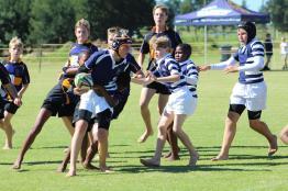 Glenwood Rugby Festival_Oakhill U13 Captain Luke Schrosbree tackled by Blanco defender (Copy)