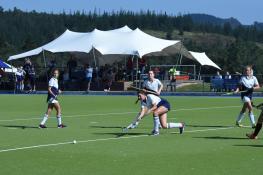Oakhill 1st team Anna Reid sharing the ball (Copy)