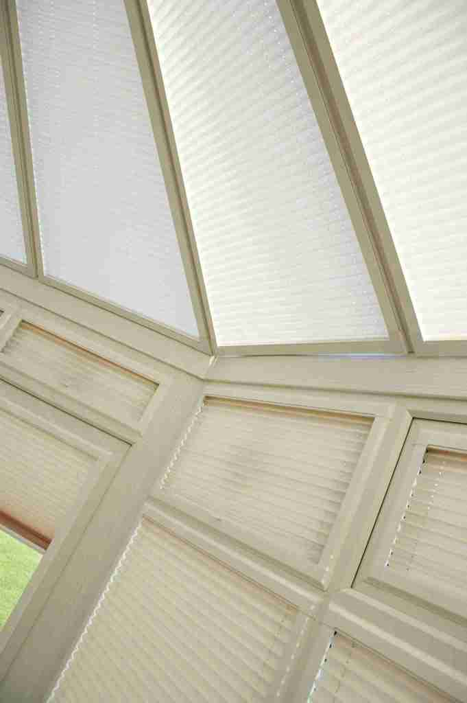 Conservatory with cream perfect fit pleated blinds in the windows and roof