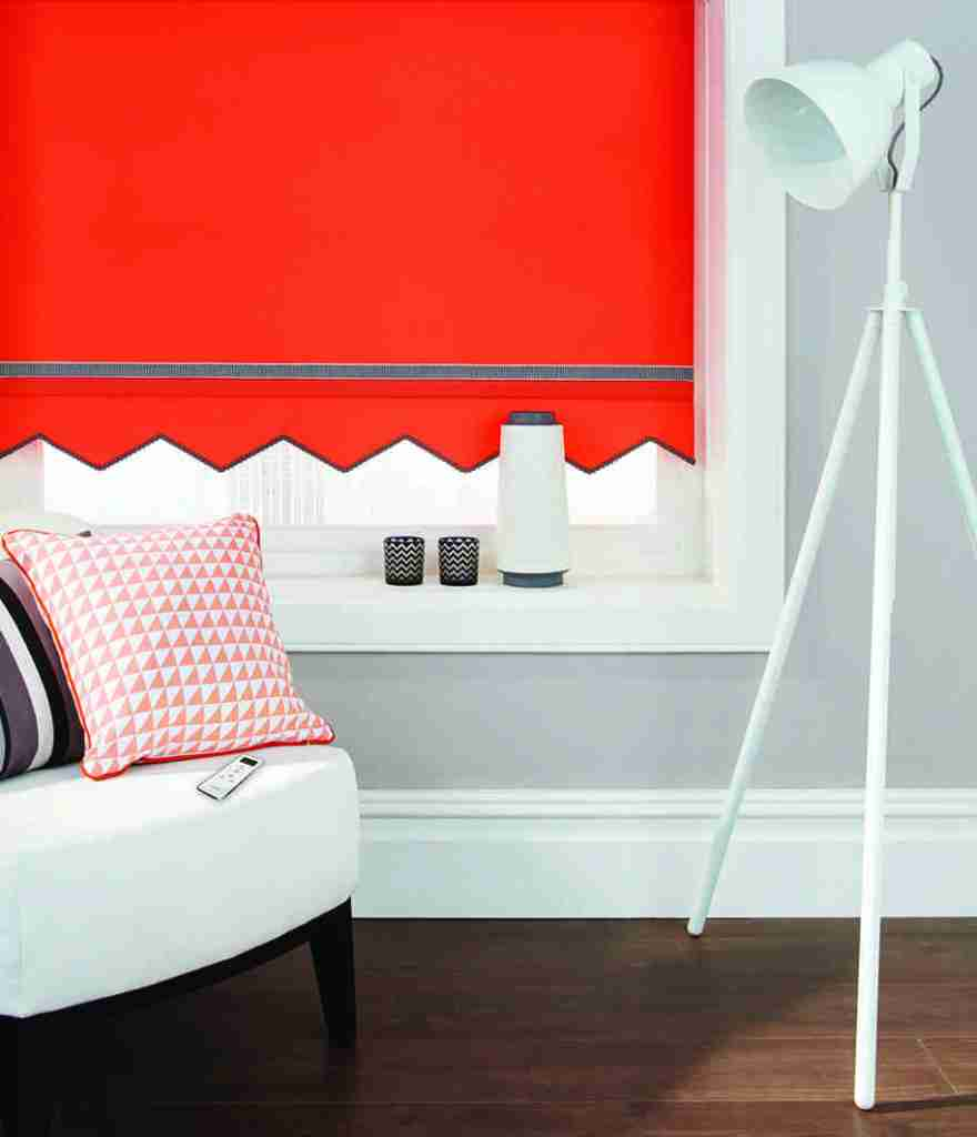 red patterned roller blind with shaped bottom